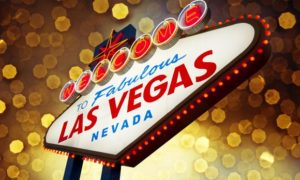 Commissioners, Candlelighters Turn Las Vegas Welcome Sign Gold for Childhood Cancer Awareness